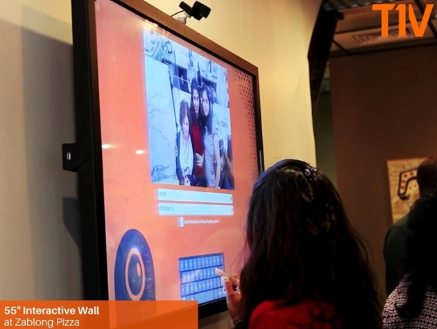 Projects: Charlotte Pizza Joint Uses Interactive To Engage Waiting Customers