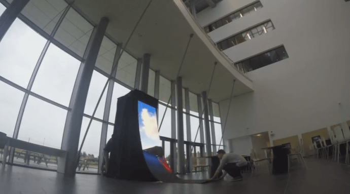 An LED Video Wall That Hand-Cranks Into Place